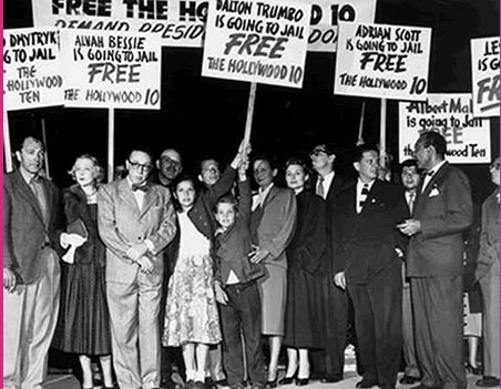 Photograph of protesters with signs reading Free the Hollywood Ten